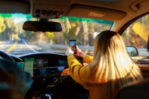 Drivers Fined for Passengers Using Mobile Devices
